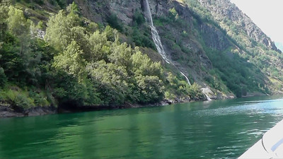 In this video clip, we're on the water in our high speed craft touring the Aurlandsfjord, getting closeup views of waterfalls, and visiting Undredal to sample their famous brown goat cheese.