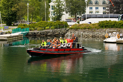 "A high speed tour boat similar to one we took for an afternoon ""fjord safari""."