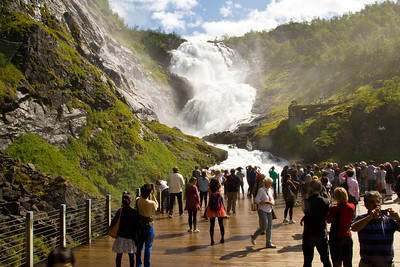 Train Passengers from the Flamsbana railway viewing the Kjosfossen Waterfall at a special viewing platform.