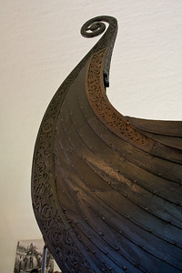 The ornately carved bow section of an old Viking ship, seen in the Viking Ship Museum in Oslo.