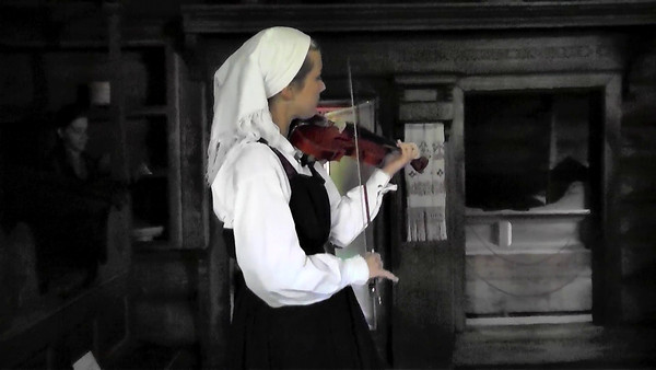 A short video clip of classical Norwegian Folk Dance Music being played in an old farmhouse in the Open Air Folk Museum near Oslo.