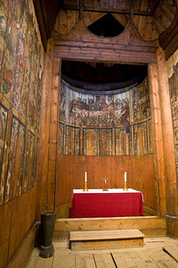 The interior of the 12th century stave church from Gol.  There was standing room only in these churches; no pews were provided.  The paintings are original, and the one above the altar depicts the Last Supper.