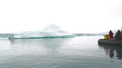 On one of our Zodiac cruises, we spotted a lone polar bear resting on a nearby iceberg.