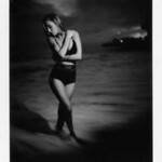 A Malibu beach boudoir photo taken on Polaroid instant film on the beach at night.