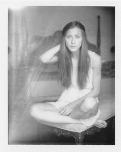 A vintage instant boudoir photo shot on film in a bed & breakfast outside Albuquerque, NM.