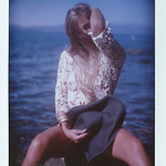 A Tahoe beach boudoir photo shot with a vintage camera on Polaroid film.