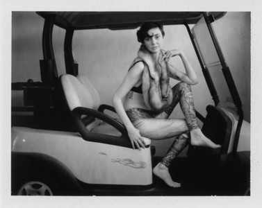 A boudoir fashion photo taken on a golf cart in Phoenix, AZ by a Phoenix boudoir photographer who uses instant film.