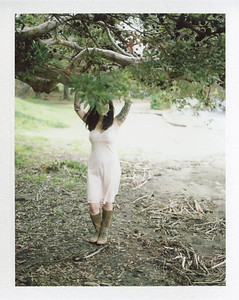 A photo from a nature boudoir shoot, taken on vintage instant film.