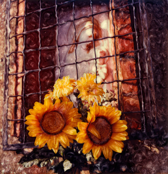 Sunflowers placed outside a roadside chapel in Tuscany