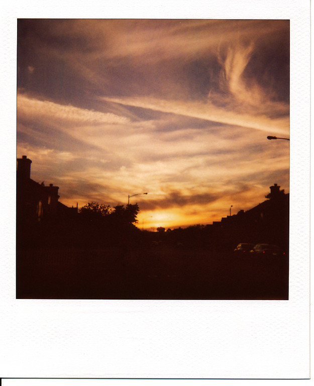 Man, I miss shooting sunsets with Polaroids and 600 film...  This isn't a perfect framing, but the colors are still pretty good.