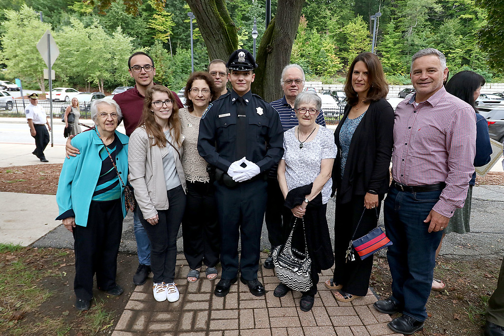 . Cadet Nicholas McLaughlin poses with his family after the Fitchburg State University\'s 1st recruit officer course graduation on Thursday September 13, 2018. From left is his grandmother Terry Piermarini, Soon to be brother-in-law Mathias Goncalves, his sister Kelly McLaughlin, his mom nancy Robillard, step dad Dteve Robillard, step grandfather Ed Robillard, step grandmother Sheila Roillard and Paster Dave and Kristi Tralongo from the Chair City Church in Gardner. SENTINEL & ENTERPRISE/JOHN LOVE