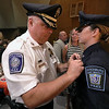 Cadet Nicole Patterson gets pinned by her dad Littleton Deputy Chief Jeff Patterson during the Fitchburg State University's 1st recruit officer course graduation on Thursday September 13, 2018. SENTINEL & ENTERPRISE/JOHN LOVE