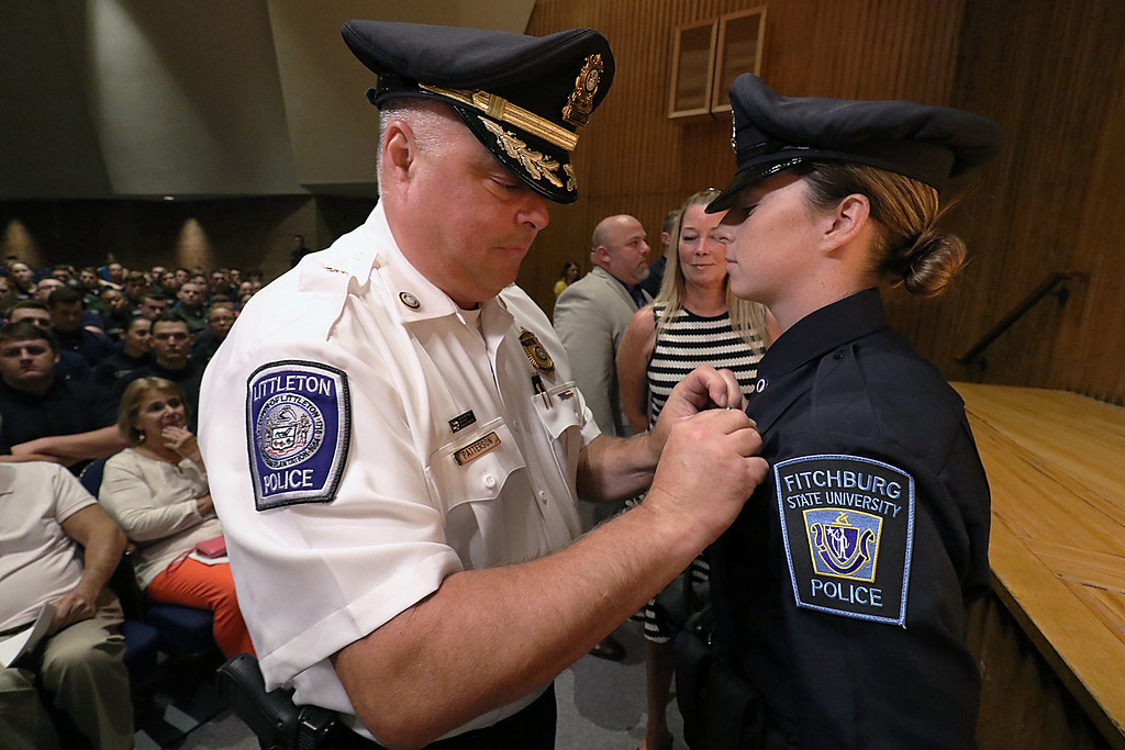 . Cadet Nicole Patterson gets pinned by her dad Littleton Deputy Chief Jeff Patterson during the Fitchburg State University\'s 1st recruit officer course graduation on Thursday September 13, 2018. SENTINEL & ENTERPRISE/JOHN LOVE