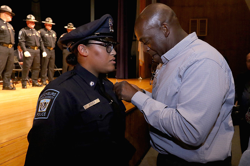 Cadet Morgan Steele gets pinned by her dad Raymond Steele during the Fitchburg State University's 1st recruit officer course graduation on Thursday September 13, 2018. SENTINEL & ENTERPRISE/JOHN LOVE