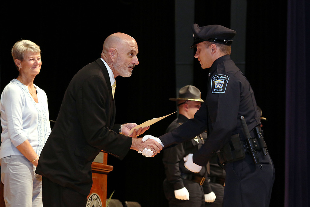. Cadet Nicholas McLaughlin of Fitchburg gets his certificate from Municipal Police Training Committee (MPTC) Executive Director Daniel Zivkovich during the Fitchburg State University\'s 1st recruit officer course graduation on Thursday September 13, 2018. SENTINEL & ENTERPRISE/JOHN LOVE