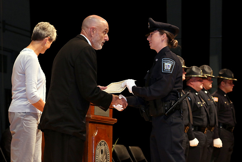 Cadet Nicole Patterson gets her certificate from Municipal Police Training Committee (MPTC) Executive Director Daniel Zivkovich during the Fitchburg State University's 1st recruit officer course graduation on Thursday September 13, 2018. SENTINEL & ENTERPRISE/JOHN LOVE