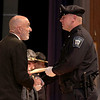 Cadet Ryan Richard gets his certificate from Municipal Police Training Committee (MPTC) Executive Director Daniel Zivkovich during the Fitchburg State University's 1st recruit officer course graduation on Thursday September 13, 2018. SENTINEL & ENTERPRISE/JOHN LOVE