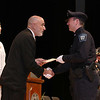 Cadet John Francis gets his certificate from Municipal Police Training Committee (MPTC) Executive Director Daniel Zivkovich during the Fitchburg State University's 1st recruit officer course graduation on Thursday September 13, 2018. SENTINEL & ENTERPRISE/JOHN LOVE