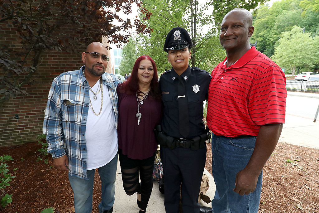 . Cadetr Jami Parker poses with her family after the Fitchburg State University\'s 1st recruit officer course graduation on Thursday September 13, 2018. From left is her uncle Arman Surita, Aunt Nancy Surita and her dad Stanley Parker. SENTINEL & ENTERPRISE/JOHN LOVE
