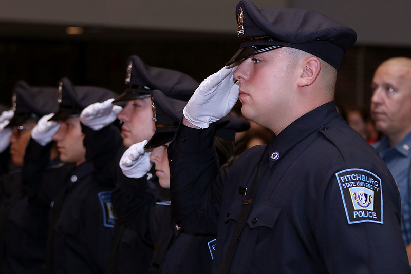 Cadet Ryan Richard salutes as the national anthem is sung during the Fitchburg State University's 1st recruit officer course graduation on Thursday September 13, 2018. SENTINEL & ENTERPRISE/JOHN LOVE