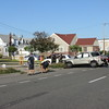 The car was T-boned and flipped into a pole. 3 were injured, all of which were minor.