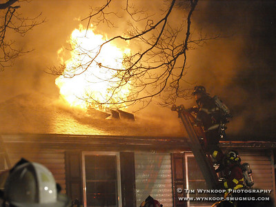 Belvidere, NJ, 2008-01-01:  A ball of fire erupts from a ventilation hole firemen made on the roof of a home engulfed by flames early Tuesday morning. The residents of the home were evacuated and there were no injuries. The cause of the fire was unknown. (Photo by: Tim Wynkoop)