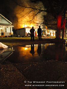 Belvidere, NJ, 2008-01-01: Neighbors watch as firefighters battle a blaze that engulfed a home at 416 Knowlton Street, Belvidere early Tuesday morning. The residents of the home were evacuated and there were no injuries. (Photo by: Tim Wynkoop)