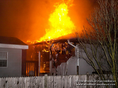 Belvidere, NJ, 2008-01-01:  Flames erupt from the rear of a home at 416 Knowlton Street, Belvidere early Tuesday morning. The residents were evacuated and no one was injuried. The cause of the blaze was unknown. (Photo by: Tim Wynkoop)