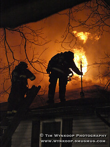Belvidere, NJ, 2008-01-01: Firefighters begin to ventilate the roof of a home at 416 Knowlton Street, Belvidere early Tuesday morning. The blaze displaced the residents from their home without any injuries. (Photo by: Tim Wynkoop)