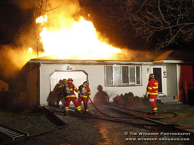 Belvidere, NJ, 2008-01-01: Good Will Firefighters arrive at a home at 416 Knowlton Street early Tuesday morning after a blaze engulfed the rear of the home. The residents were evacuated and there were no injuries. (Photo by: Tim Wynkoop)