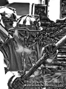 Lopatcong Township, NJ, 08/28/2008: Lopatcong Township fireman, Dave Jiorle, suited up and helped man a hose at the fire.