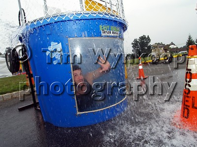 Washington Township (Warren County), NJ, 08-07-2007: Washington Township police officer Ron Pantuso takes the plunge in the dunk tank Tuesday night for the township's National Night Out celebration. (Photo by: Tim Wynkoop)