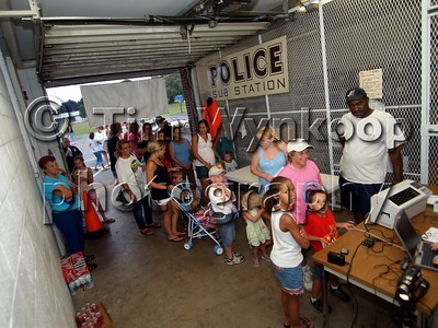 Phillipsburg, NJ, 08-07-2007: Phillipsburg resident line up to get free fingerprinting at the Phillipsburg Police headquarters Tuesday night during the town's National Night Out Celebration. (Photo by: Tim Wynkoop)