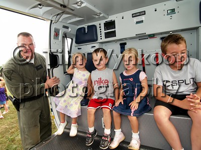 Greenwich Township, NJ, 08-07-2007: Maura Harnett 4, left, Matthew Contiliano, 3 and Mckenna Harnett 4, all of Stewartsville and T. J. Callari, 9, of Greenwich Township, all got a chance to see the inside of a New Jersey State Police helicopter during the National Night Out celebration in the township Tuesday night. (Photo by: Tim Wynkoop)