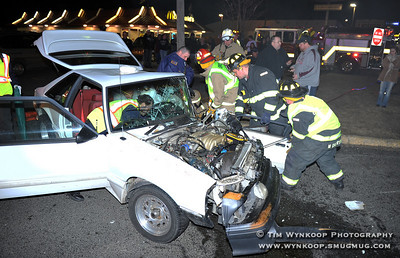 Phillipsburg, NJ, 2/24/2009: Rescue workers prepare to extricate a man from a Ford Mustang after it struck a tractor-trailer on Memorial Parkway in Phillipsburg about 10:30 Tuesday night and landed in the entrance to Ahart's Market. The driver was flown to St. Luke's Hospital and with unknown extent of injuries. Express-Times Photo | TIM WYNKOOP