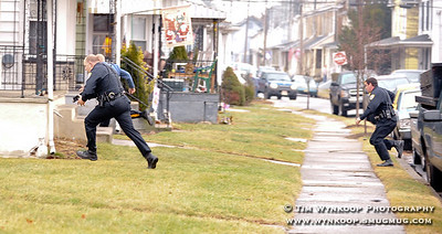 Phillipsburg, NJ, 1/24/2010: Phillipsburg and New Jersey State Police begin a short foot pursuit through yards on Irwin Street in Phillipsburg, for a man who fled a stolen car after chase through town Sunday.  Express-Times Photo | TIM WYNKOOP
