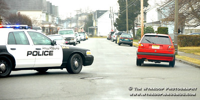 Phillipsburg, NJ, 1/24/2010: Phillipsburg police, in a cruiser equipped with license plate detection cameras on the light bar, pursue a stolen Volkswagen GTI as it turns from Irwin Street onto Firth Street in the town Sunday. Express-Times Photo | TIM WYNKOOP