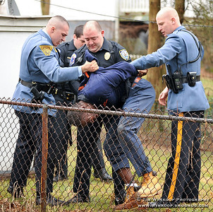 Phillipsburg, NJ, 1/24/2010: Police bring a man to his feet Sunday, after being taken into custoday after he fled from a car reported stolen. Express-Times Photo | TIM WYNKOOP