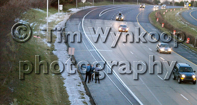 Pohatcong Township, NJ, 12/25/2008: Police search an embankment along Route 78 West bound for a man wanted in connection with a car chase out of Pennsylvania that crashed in Pohatcong Township, NJ Thursday. Express-Times Photo | TIM WYNKOOP