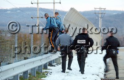 Pohatcong Township, NJ, 12/25/2008: Police from Pennsylvania State Police, New Jersey State Police, Greenwich Township and Lopatcong Township police departments react to a radioed report of a second man wanted in connection with a car chase and crash in Pohatcong Township being see along the embankment of Route 78 East bound. Express-Times Photo | TIM WYNKOOP