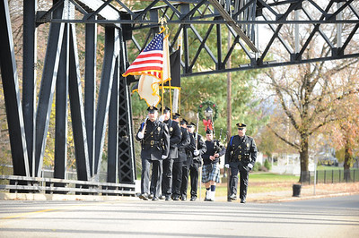 "The Phillipsburg Police Honor Guard carries the Colors across the bridge. Phillipsburg Police Department held a remembrance ceremony honoring fallen officer, Kenneth W. ""Red"" Vandegrift who died in the line of duty Nov. 20, 1930. The ceremony was at the bridge on South Main Street that bears his name."