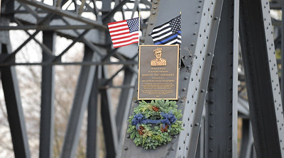 "A bronze plaque memorializing Kenneth W. ""Red"" Vandegrift is affixed to the bridge in the 200 block of South Main Street, Phillipsburg. The Phillipsburg Police Department held a remembrance ceremony honoring fallen officer, Kenneth W. ""Red"" Vandegrift who died in the line of duty Nov. 20, 1930. The ceremony was at the bridge on South Main Street that bears his name."
