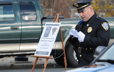 "Phillipsburg Police Sgt. James McDonald stands next to a memorial board as he reads the account of of Vandegrift's death in 1930. The Phillipsburg Police Department held a remembrance ceremony honoring fallen officer, Kenneth W. ""Red"" Vandegrift who died in the line of duty Nov. 20, 1930. The ceremony was at the bridge on South Main Street that bears his name."