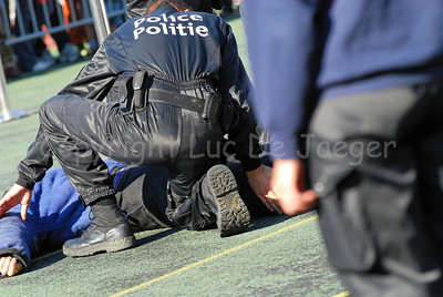 The arrest of a suspect by a police dog and his handler, member of the dog support unit of the federal police. The officer wears Magnum boots.