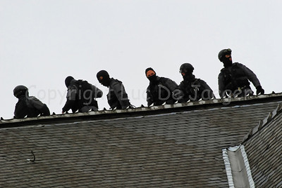 Members of the Special Intervention Squadron (SIE) on top of the roof. Photo captured during totally overcast weather.
