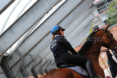 A female member of the federal mounted police going on patrol.