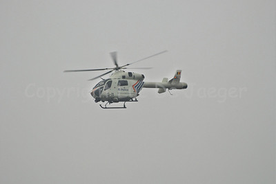 The McDonnell Douglas Explorer 900 helicopter of the Belgian  federal police with the so-called NOTAR system (No Tail Rotor). The MD 900 Explorer can fly at night and is equipped with other hi-tech material and gear. This photo was captured during a search for a missing person. Photo captured during totally overcast and misty weather.