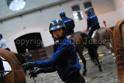 A female member of the mounted police during a training session.