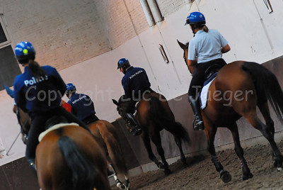 Members of the federal mounted police training the horses.