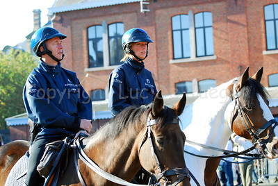 Two officers of the mounted police on patrol.